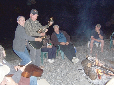 beach fire singing and playing