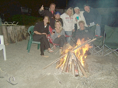 Guests enjoying a beach fire